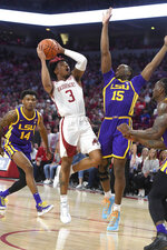 FILE - Arkansas guard Desi Sills(3) drives past LSU defenders Marlon Taylor (14) and Aundre Hyatt (15) during the first half of an NCAA college basketball game in Fayetteville, Ark., in this Wednesday, March 4, 2020, file photo. Arkansas will have a distinctly different look this season. Isaiah Joe and Mason Jones left school early and declared for the NBA Draft, leaving the Razorbacks without their combined 39 points per game. Sills, one of the returnees, averaged 12.4 points over the final 14 games last season. (AP Photo/Michael Woods, FIle)