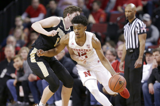 Nebraska's Thomas Allen (12) drives around Purdue's Ryan Cline (14) during the first half of an NCAA college basketball game in Lincoln, Neb., Saturday, Feb. 23, 2019. (AP Photo/Nati Harnik)