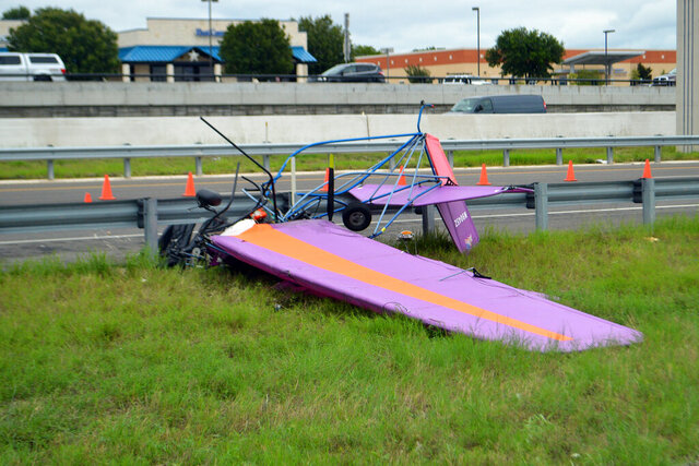 An ultralight aircraft sits mangled along Interstate 14 and the East Central Texas Expressway in front of Seton Medical Center in Harker Heights, Texas, Thursday, Sept. 24, 2020. Two people were killed in the accident, authorities said. (Thaddeus Imerman/The Killeen Daily Herald via AP)