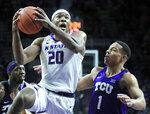 Kansas State forward Xavier Sneed (20) drives past TCU guard Desmond Bane (1) during the second half of an NCAA college basketball game in Manhattan, Kan., Saturday, Jan. 19, 2019. Sneed scored 18 points in the game. Kansas State defeated TCU 65-55. (AP Photo/Orlin Wagner)