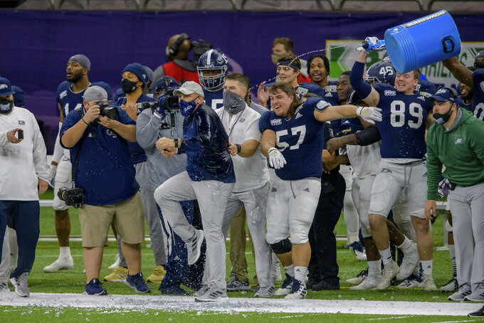 Georgia Southern coach Chad Lunsford gets doused as the team starts to celebrate a win over over Louisiana Tech in the New Orleans Bowl NCAA college football game in New Orleans, Wednesday, Dec. 23, 2020. (AP Photo/Matthew Hinton)