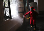 A firefighter sprays disinfectant at the Fine Arts and Ceramic Museum prior to its reopening later this week after weeks of closure due to the large-scale restrictions imposed to curb the spread of the new coronavirus outbreak, in Jakarta, Indonesia, Monday, June 15, 2020. As Indonesia's overall virus caseload continues to rise, the capital city has moved to restore normalcy by lifting some restrictions, saying that the spread of the virus in the city of 11 million has slowed after peaking in mid-April. (AP Photo/Dita Alangkara)
