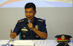 Philippine National Police spokesperson PCol. Bernard Banac answers questions from the media during a joint news conference with his counterpart in the armed forces Brig.Gen. Edgard Arevalo at Camp Aguinaldo Wednesday, July 10, 2019 in suburban Quezon city northeast of Manila, Philippines. Both Arevalo and Banac say a DNA test has confirmed the identity of the first known Filipino suicide bomber named as Norman Lasuca. Two attackers carrying explosives killed three soldiers, two villagers and themselves and wounded 22 others in a June 28 attack on an army camp in southern Sulu province. The second attacker remains unidentified. (AP Photo/Bullit Marquez)