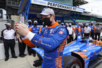 Scott Dixon, of New Zealand, takes a photo after winning the pole for the Indianapolis 500 auto race at Indianapolis Motor Speedway, Sunday, May 23, 2021, in Indianapolis. (AP Photo/Darron Cummings)