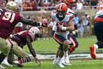 Syracuse's Tommy DeVito, right, tries to run around Florida State's Robert Cooper during the first quarter of an NCAA college football game, Saturday, Oct. 26, 2019, in Tallahassee Fla. (AP Photo/Steve Cannon)