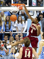 Elon's Marcus Sheffield II (4) dunks during the first half of an NCAA college basketball game against North Carolina in Chapel Hill, N.C., Wednesday, Nov. 20, 2019. (AP Photo/Ben McKeown)