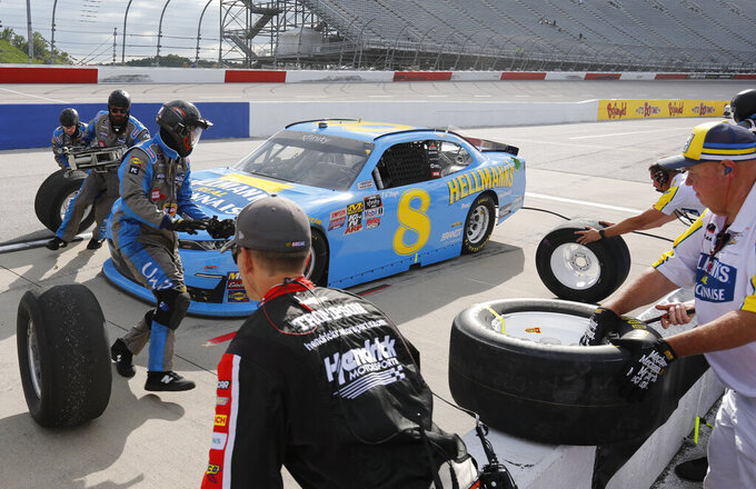 Dale Earnhardt Jr makes a pit stop during the NASCAR Xfinity Series auto race on Saturday, Aug. 31, 2019, at Darlington Raceway in Darlington, S.C.. (AP Photo/Terry Renna)