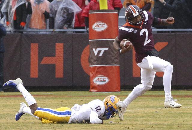 Virginia Tech quarterback Hendon Hooker (2) escapes Paris Ford (12) of Pittsburgh in the first half of an NCAA college football game in Blacksburg Va. Saturday, Nov. 23 2019. (Matt Gentry/The Roanoke Times via AP)