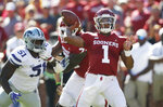 Oklahoma quarterback Kyler Murray (1) throws in front of Kansas State defensive end Reggie Walker (51) in the first half of an NCAA college football game in Norman, Okla., Saturday, Oct. 27, 2018. (AP Photo/Sue Ogrocki)