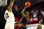 Georgia's Anthony Edwards (5) takes a shot over Texas A&M forward Josh Nebo (32) during an NCAA basketball game in Athens, Ga., on Saturday, Feb. 1, 2020. (Joshua L. Jones/Athens Banner-Herald via AP)