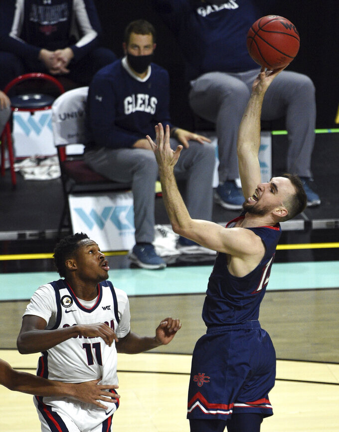 Saint Mary's guard Tommy Kuhse (12) shoots against Gonzaga guard Joel Ayayi (11) during the second half of an NCAA semifinal college basketball game at the West Coast Conference tournament Monday, March 8, 2021, in Las Vegas. (AP Photo/David Becker)