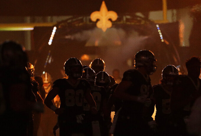 The New Orleans Saints are introduced before the NFL football NFC championship game against the Los Angeles Rams, Sunday, Jan. 20, 2019, in New Orleans. (AP Photo/David J. Phillip)