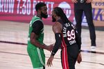 Boston Celtics' Jaylen Brown, left, and Miami Heat's Jae Crowder (99) exchange words during the second half of an NBA conference final playoff basketball game, Saturday, Sept. 19, 2020, in Lake Buena Vista, Fla. (AP Photo/Mark J. Terrill)
