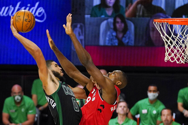 Boston Celtics' Jayson Tatum (0) tries to get a shot over Toronto Raptors' Serge Ibaka (9) during the second half of an NBA conference semifinal playoff basketball game Monday, Sept. 7, 2020, in Lake Buena Vista, Fla. (AP Photo/Mark J. Terrill)