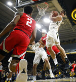 Iowa forward Luka Garza, center, rips down a rebound during the first half against Ohio State in an NCAA college basketball game, Saturday, Jan. 12, 2019, in Iowa City Iowa. (AP Photo/Matthew Putney)