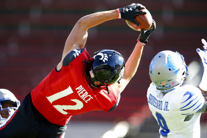 Cincinnati wide receiver Alec Pierce (12) catches a touchdown pass during the first half of an NCAA college football game against Memphis, Saturday, Oct. 31, 2020, in Cincinnati.  (Kareem Elgazzar/The Cincinnati Enquirer via AP)