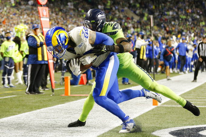 Los Angeles Rams tight end Tyler Higbee (89) is tacked by Seattle Seahawks safety Jamal Adams, right, as Higbee scores a touchdown during the second half of an NFL football game, Thursday, Oct. 7, 2021, in Seattle. (AP Photo/Craig Mitchelldyer)