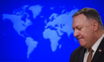 Secretary of State Mike Pompeo speaks during a news conference at the State Department on Wednesday, March 25, 2020, in Washington. Pompeo said Wednesday that the Group of Seven members were all aware of China's