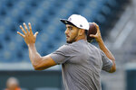 FILE - In this Aug. 8, 2019, file photo, Tennessee Titans quarterback Marcus Mariota warms up before a preseason NFL football game in Philadelphia. Tennessee plays at Cleveland on Sunday. (AP Photo/Matt Rourke, Fle)