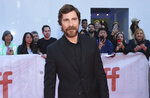 Christian Bale attends a premiere for