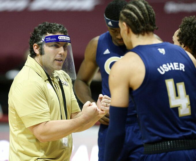 Georgia Tech head coach Josh Pastner speaks with Jordan Usher (4) during the first half of an NCAA college basketball game against Virginia Tech Tuesday, Feb. 23, 2021, in Blacksburg, Va. (Matt Gentry/The Roanoke Times via AP, Pool)