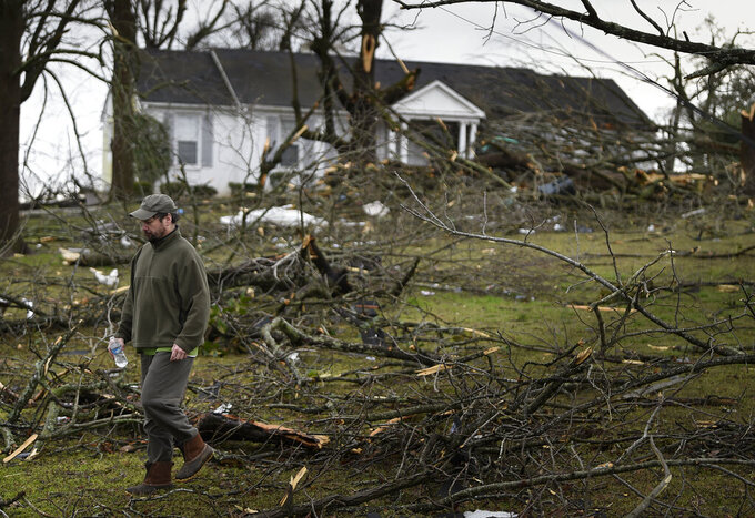 In this Tuesday, March 3, 2020 photo, Sid Osborne surveys the damage at his home on Hunters Hill Rd. after a tornado ripped through the Donelson neighborhood in Nashville, Tenn. (George Walker IV/The Tennessean via AP)