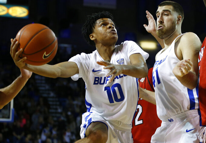 FILE - In this Saturday, Jan. 12, 2019, file photo, Buffalo guard Ronaldo Segu (10) looks to shoot against Miami of Ohio as center Brock Bertram (41) helps clear the lane during the first half of an NCAA college basketball game, in Buffalo N.Y. Buffalo is off to its best start in school history. (AP Photo/Jeffrey T. Barnes, File)