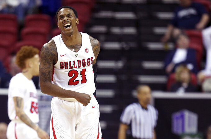 Fresno State's Deshon Taylor reacts during the first half of an NCAA college basketball game against Air Force in the Mountain West Conference men's tournament Thursday, March 14, 2019, in Las Vegas. (AP Photo/Isaac Brekken)