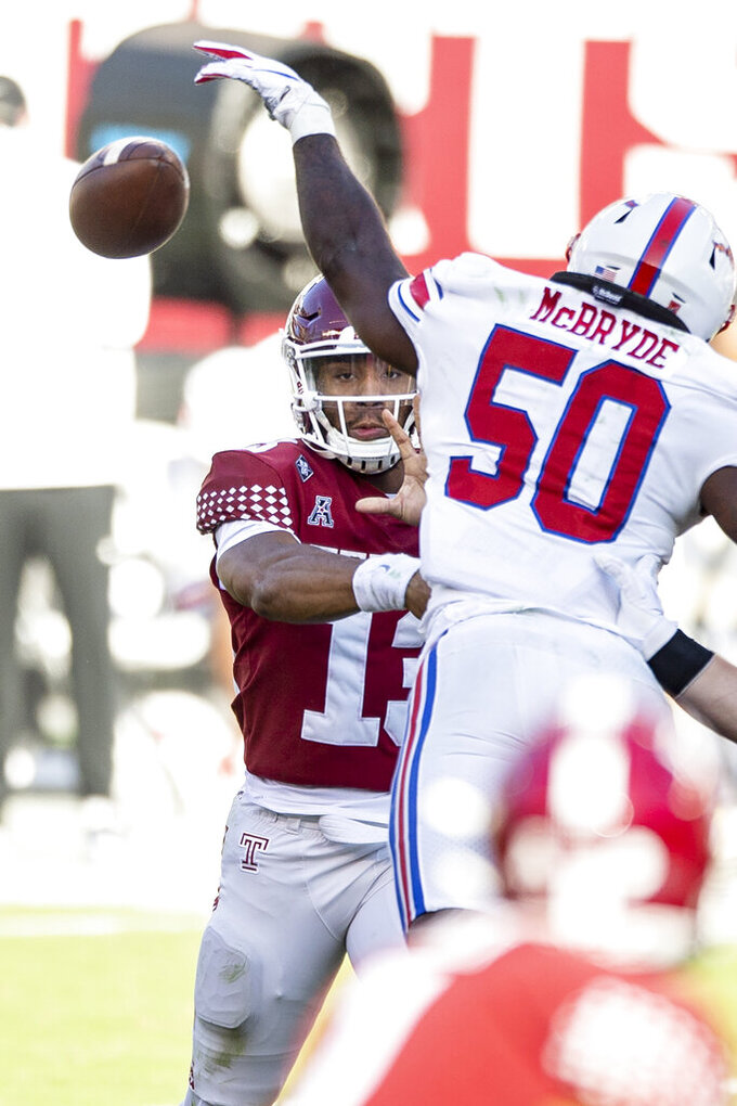 SMU linebacker Richard McBryde (50) deflects a pass by Temple quarterback Re-al Mitchell (13) during the second half of an NCAA college football game, Saturday, Nov. 7, 2020, in Philadelphia. SMU won 47-23. (AP Photo/Laurence Kesterson)