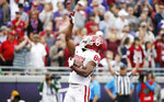 Oklahoma wide receiver Lee Morris (84) points skyward after scoring a touchdown during the first half of an NCAA college football game against TCU, Saturday, Oct. 20, 2018, in Fort Worth, Texas. (AP Photo/Brandon Wade)