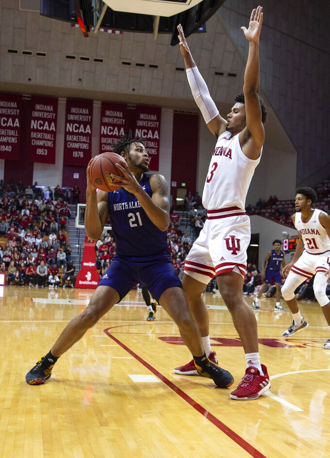 North Alabama's Emanuel Littles (21) tries to get the ball around the defense of Indiana's Justin Smith (3) during the second half of an NCAA college basketball game, Tuesday, Nov. 12, 2019, in Bloomington, Ind. Indiana won 91-65. (AP Photo/Doug McSchooler)