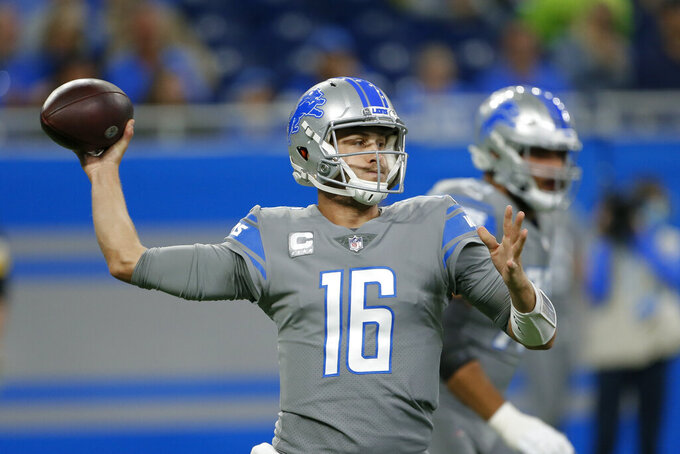 Detroit Lions quarterback Jared Goff (16) throws against the Baltimore Ravens in the first half of an NFL football game in Detroit, Sunday, Sept. 26, 2021. (AP Photo/Duane Burleson)