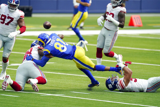Los Angeles Rams tight end Gerald Everett (81) fumbles the ball which would then be recovered by the New York Giants during the first half of an NFL football game Sunday, Oct. 4, 2020, in Inglewood, Calif. (AP Photo/Ashley Landis)