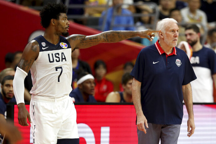 United States' Marcus Smart points near United States' coach Gregg Popovich during a quarterfinal match against France for the FIBA Basketball World Cup in Dongguan in southern China's Guangdong province on Wednesday, Sept. 11, 2019. France defeated United States 89-79. (AP Photo/Ng Han Guan)