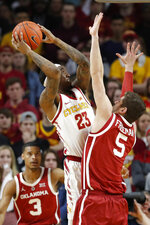 Iowa State forward Zoran Talley Jr. (23) shoots over Oklahoma forward Matt Freeman (5) during the first half of an NCAA college basketball game, Monday, Feb. 25, 2019, in Ames, Iowa. (AP Photo/Charlie Neibergall)