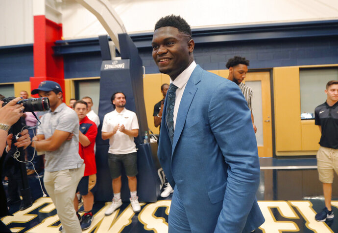 New Orleans Pelicans first-round draft pick Zion Williamson arrives for his introductory news conference at the NBA basketball team's practice facility in Metairie, La., Friday, June 21, 2019. (AP Photo/Gerald Herbert)