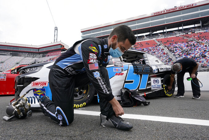 Jeremy Clements puts on his heat shields before the NASCAR Xfinity Series auto race Friday, Sept. 18, 2020, in Bristol, Tenn. (AP Photo/Steve Helber)