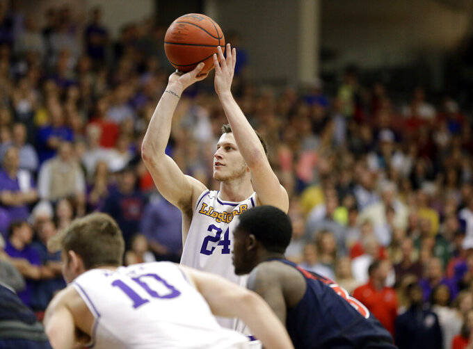 Lipscomb guard Garrison Mathews (24) shoots a free throw against Liberty in the second half of the Atlantic Sun NCAA college basketball tournament championship game Sunday, March 10, 2019, in Nashville, Tenn. Mathews led all scorers with 21 points but Liberty won 74-68. (AP Photo/Mark Humphrey)