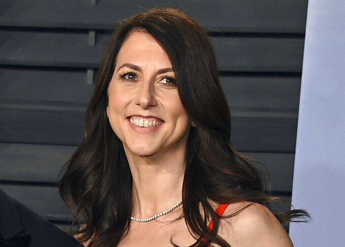 FILE - In this March 4, 2018, file photo, MacKenzie Bezos arrives at the Vanity Fair Oscar Party in Beverly Hills, Calif. Philanthropists Melinda French Gates, MacKenzie Scott and the family foundation of billionaire Lynn Schusterman awarded $40 million Thursday, July 29, 2021, to four gender equality projects. (Photo by Evan Agostini/Invision/AP, File)