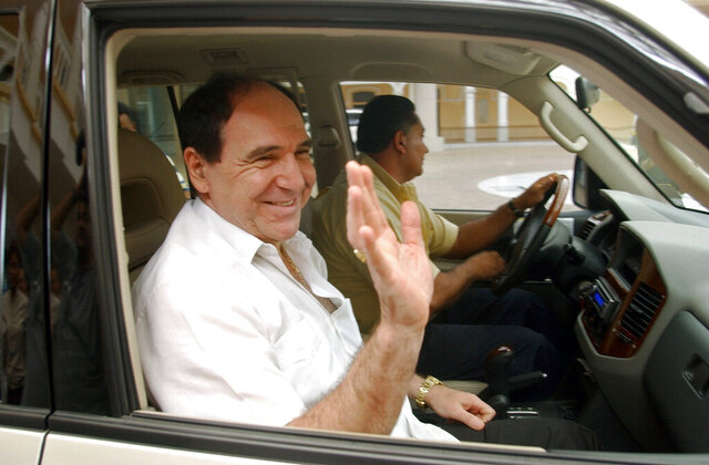 FILE - In this April 27, 2005 file photo, Ecuador's former President Abdala Bucaram leaves the Foreign Ministery in Panama City, where he sought political asylum after fleeing his country amid massive protests that forced the ouster of President Lucio Gutierrez. Bucaram was detained at his home in Guayaquil, Ecuador on June 3, 2020, during a search warrant ordered by the Prosecutor's Office investigating alleged embezzlement through a contract for hospital medical supplies. (AP Photo/Arnulfo Franco, File)
