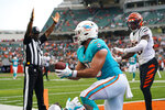 Miami Dolphins tight end Chris Myarick (85) reacts after a catch for a touchdown against the Cincinnati Bengals in the second half of an NFL exhibition football game in Cincinnati, Sunday, Aug. 29, 2021. (AP Photo/Bryan Woolston)