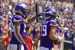 Minnesota Vikings wide receiver Adam Thielen (19) is greeted by tight end Tyler Conklin (83) after he made a catch for a touchdown against the Cincinnati Bengals in the first half of an NFL football game, Sunday, Sept. 12, 2021, in Cincinnati. (AP Photo/Aaron Doster)