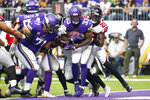 Minnesota Vikings running back Dalvin Cook (33) scores on a 7-yard touchdown run ahead of Atlanta Falcons strong safety Keanu Neal (22) during the second half of an NFL football game, Sunday, Sept. 8, 2019, in Minneapolis. (AP Photo/Bruce Kluckhohn)