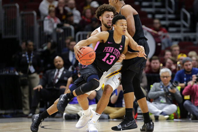 Penn State's Rasir Bolton (13) drives against Minnesota's Gabe Kalscheur during the first half of an NCAA college basketball game in the second round of the Big Ten Conference tournament, Thursday, March 14, 2019, in Chicago. (AP Photo/Kiichiro Sato)