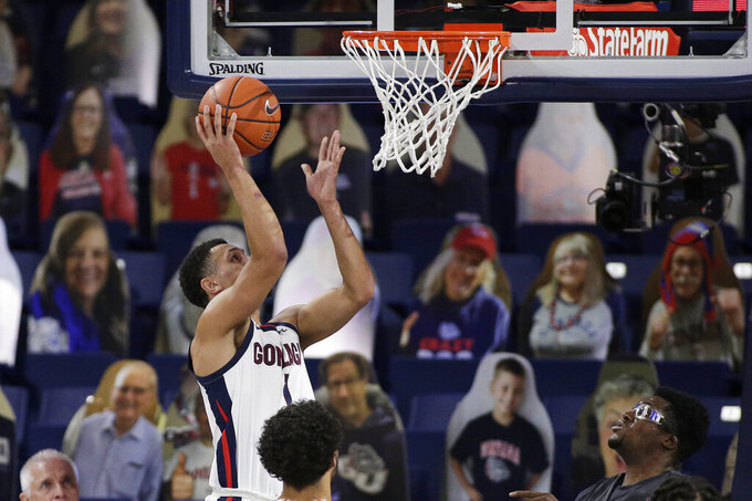 Gonzaga guard Jalen Suggs shoots during the first half of an NCAA college basketball game against Santa Clara in Spokane, Wash., Thursday, Feb. 25, 2021. (AP Photo/Young Kwak)