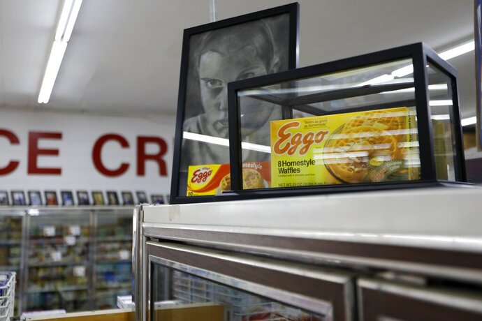 In this Monday, July 22, 2019 photo, a box of Eggo Homestyle Waffles used as a prop in Netflix's Stranger Things sits atop a refrigerator in Piggly Wiggly grocery store in Palmetto, Ga. Stranger Things filmed scenes for seasons one and three at Piggly Wiggly, formerly known as Bradley's Big Buy, including a scene in which a character steals boxes of waffles. (AP Photo/Andrea Smith)