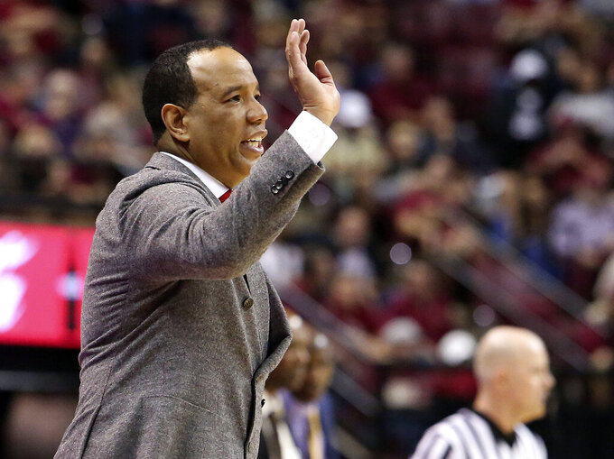 North Carolina State's head coach Kevin Keatts directs his team during the second half of an NCAA college basketball game with Florida State, Saturday, March 2, 2019, in Tallahassee, Fla. Florida State won 78-73. (AP Photo/Steve Cannon)