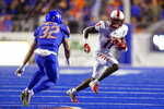 New Mexico wide receiver Emmanuel Logan-Greene, right, runs after a reception as Boise State safety Jordan Happle, left, moves in for the tackle during the first half of an NCAA college football game Saturday, Nov. 16, 2019, in Boise, Idaho. (AP Photo/Steve Conner)