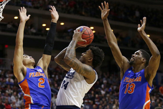 No. 10 seed Florida stops Nevada comeback for 70-61 upset