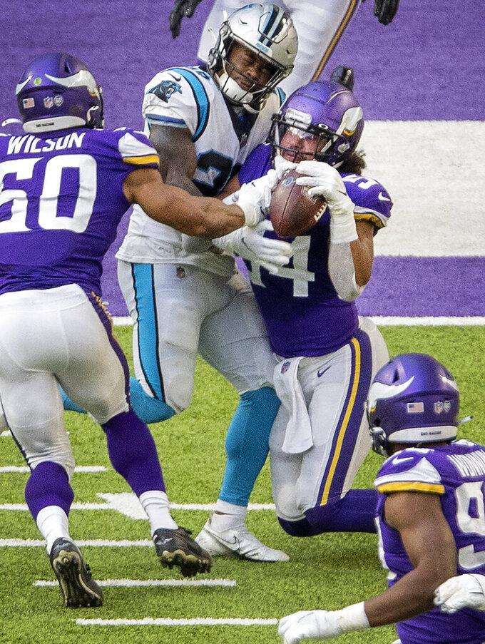 Minnesota Vikings linebacker Eric Kendricks (54) intercepts a pass from Carolina Panthers quarterback Teddy Bridgewater (not shown) in the second quarter of an NFL football game in Minneapolis, Sunday, Nov. 29, 2020. (Carlos Gonzalez/Star Tribune via AP)